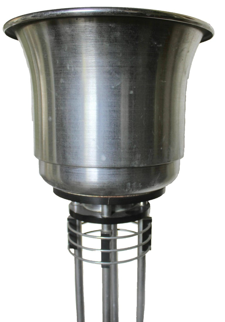 Designed to hold umbrellas, canes etc. in the lower section, with a decorative planter at the top. It stands 45 inches tall from the floor to the top of the planter pot. Planter pot diameter is 12 inches high 10 inches. It is metal, and sports its