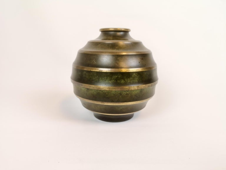 Wonderful Art Deco vase made in Sweden. The vase itself is made by SVM. It's in patinated bronze and brass.   It's in good condition with wear and patina  Measures: H 18, D 19 cm.