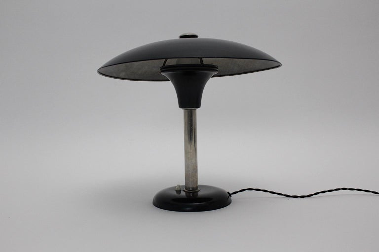 An Art Deco vintage black chrome table lamp or desk lamp designed by Max Schumacher 1934 Germany and executed by Werner Schröder, Lobenstein, Germany. The black lacquered metal table lamp shows a beautiful shade like a mushroom with a chromed stem