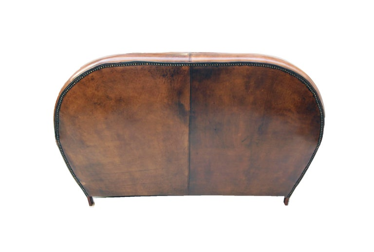 This club sofa, is covered with hand-patinated sheep leather. The couch have a very nice Art Deco shape. The leather is very sturdy and it is very comfortable to sit.