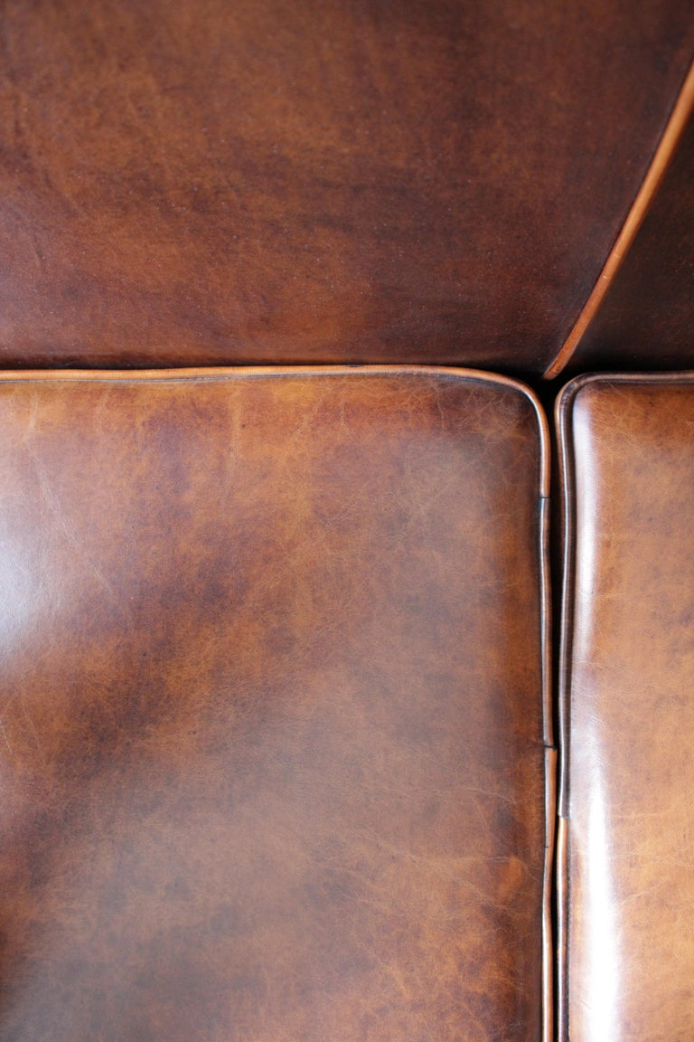 Patinated Art Deco Vintage Brown-Cognac Leather Club Sofa For Sale