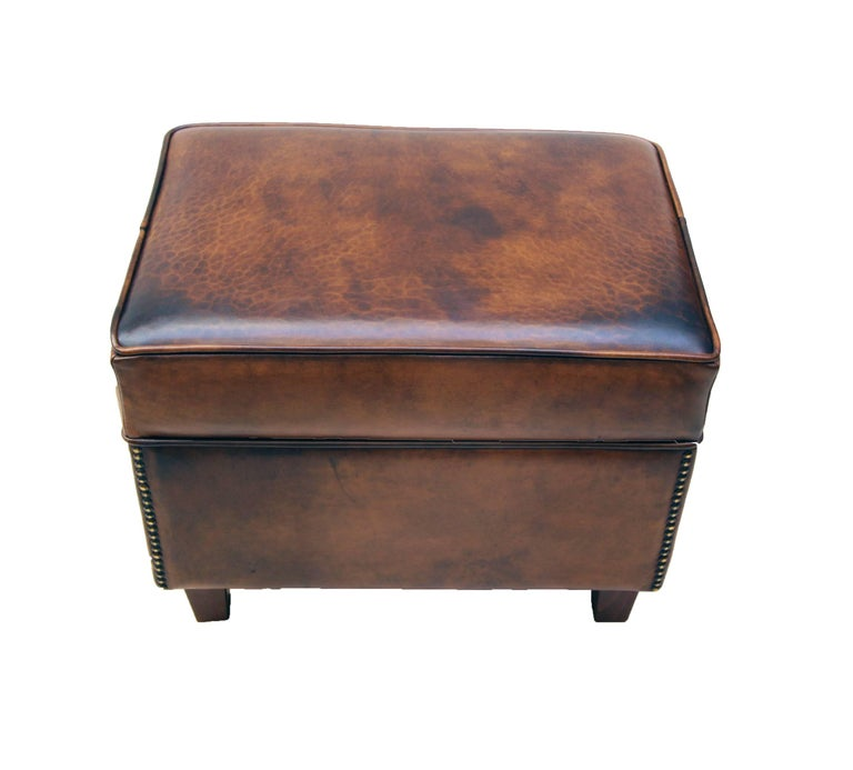 This club stool, is covered with hand-patinated sheep leather. The stool have a very nice easy shape. The leather is very sturdy and it is very comfortable.