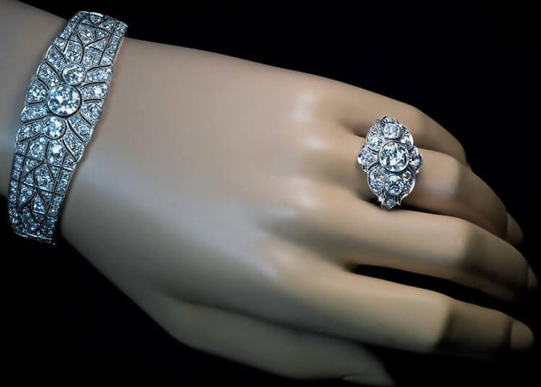 This magnificent original Art Deco platinum and diamond bracelet was crafted in the late 1920s – early 1930s. The bracelet is centered with a transitional brilliant cut diamond (8.30 x 4.55 mm, approximately 2 ct, G-H color, I1 clarity), flanked by