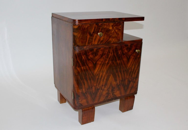 A beautiful Art Deco Austrian rosewood chest / nightstand, which was designed and made in the 1930s. The chest was made out of rosewood veneer, root wood, spruce and brass. The Art Deco chest has a useful inner life with one drawer and one