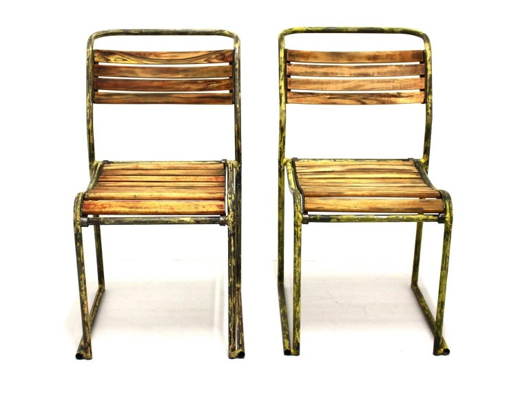 Art Deco vintage steel chairs model RP6 by Bruno Pollak 1931-1932 and manufactured by PEL Ltd. England. The beechwood slats and the tubular steel from this rare pair of chairs show lovely rests from yellow enamel.  Also they are carefully cleaned