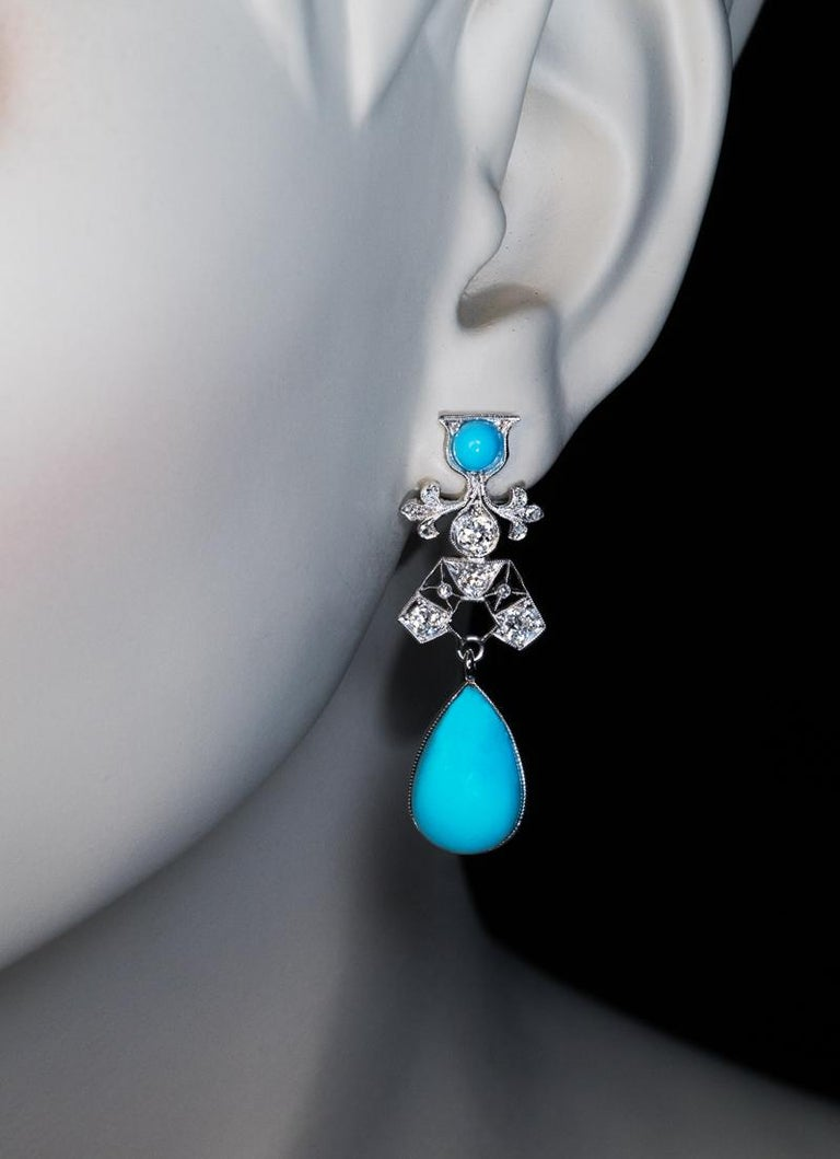 Circa 1930  The platinum openwork Art Deco earrings with 18K white gold studs are set with vivid sky blue turquoise accented by old cut diamonds. The turquoise drops measure 16.17 x 10.68 x 6.26 mm and 16.23 x 11.18 x 6.09 mm.  Estimated total
