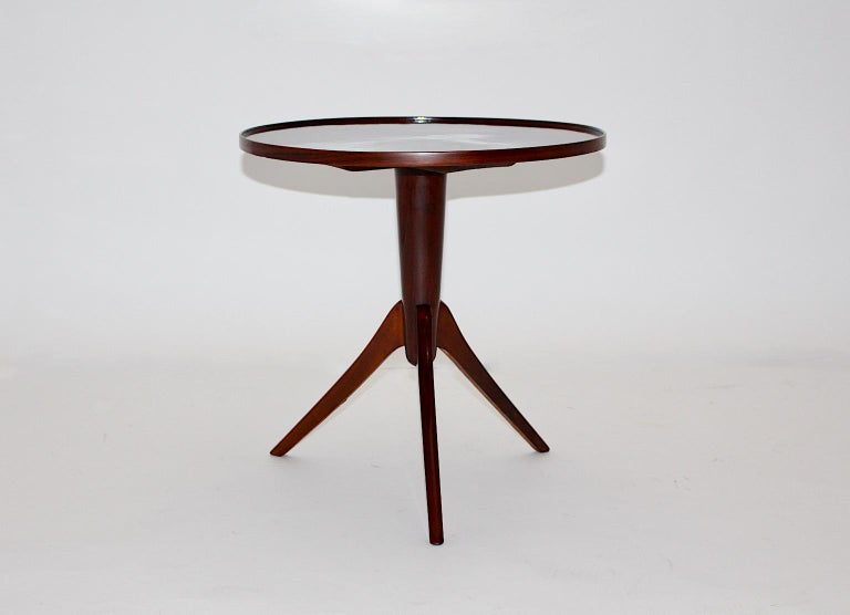 Art Deco vintage beautiful side table from walnut design attributed to Josef Frank 1930s Vienna. The stellar shaped walnut veneers form an amazing veneer picture at the top, while the three legs made from solid walnut promise a good stability. The