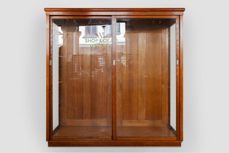 A beautiful Art Deco display cabinet from a former Haute Couture Dress store, suitable for hanging long dresses or coats also very effective for exhibiting your collection in a Wunderkammer setup or for presenting large objects. The furniture is