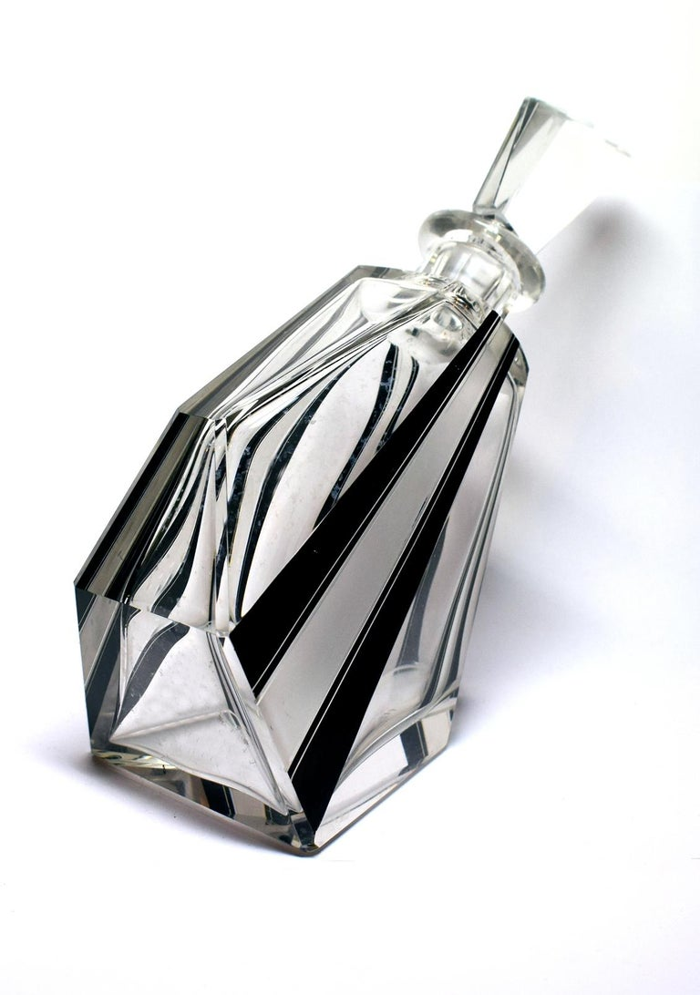 Unusual shaped 1930s Art Deco glass decanter with black enamel overlay design. This beautiful decanter displays wonderfully and is ideal to accompany a cocktail cabinet or set out on a drinks cart or tray. Very heavy and shows real signs of quality.