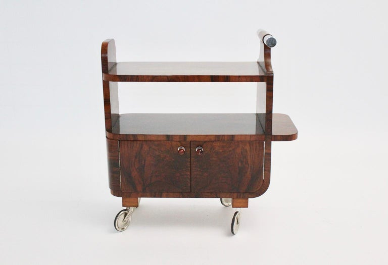 An Art Deco walnut nickel vintage bar cart, which was designed and manufactured in Vienna, circa 1930.
