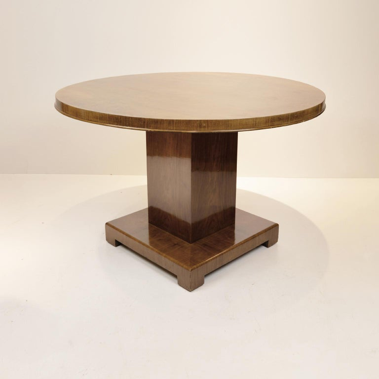 Art Deco walnut round dining table, Germany, circa 1930.