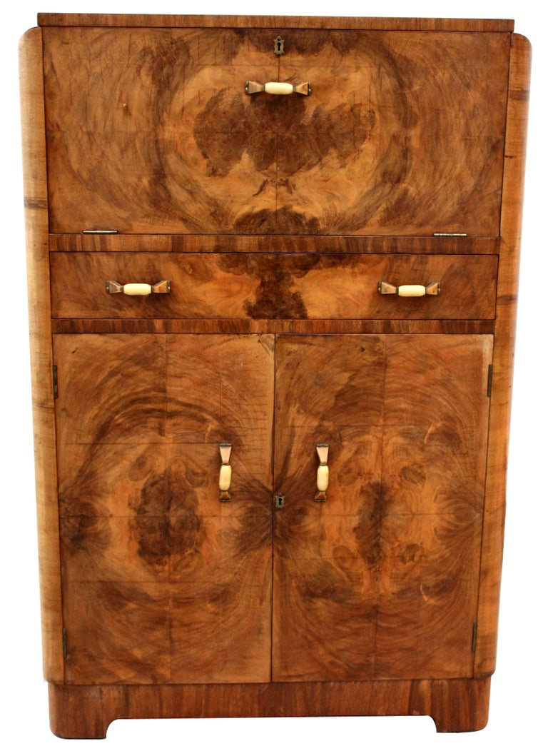 For your consideration is this superbly stylish and totally authentic 1930s Art Deco walnut upright cocktail cabinet, every Deco interior should have one of these. Originating from England and dating to the mid-1930s this cabinet offers lots of