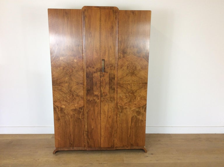 Art Deco wardrobe in a stunning figured walnut with skyscraper front.