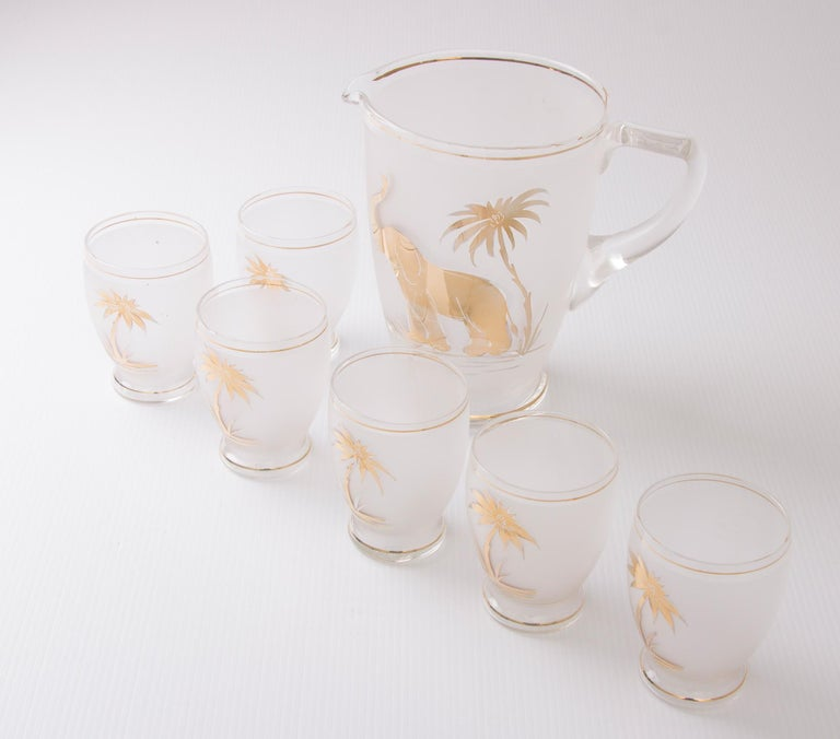 Art Deco frosted glass water set with gilded elephant and palm tree design