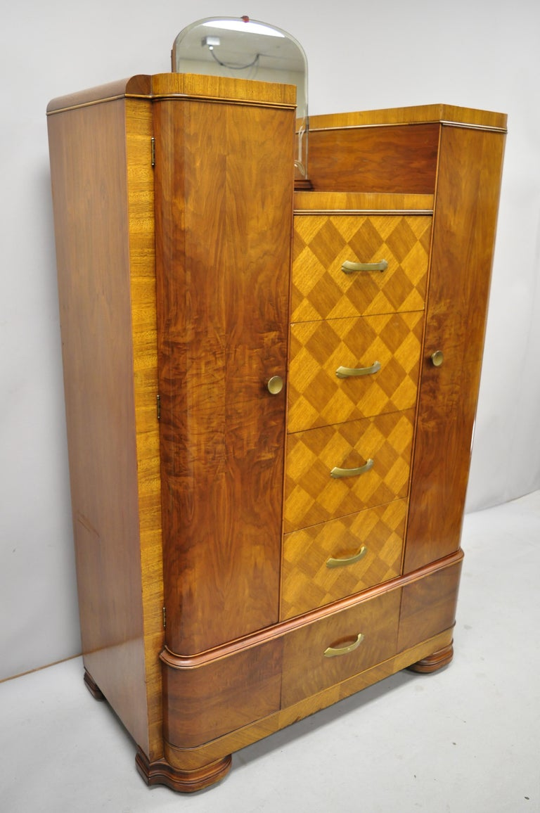 Art Deco Waterfall chest dresser armoire wardrobe cedar chest with mirror by tri-bond. Item includes cedar lined cabinets, etched mirror, beautiful wood grain, 2 swing doors, 5 dovetailed drawers, very nice antique item, circa early 20th century.