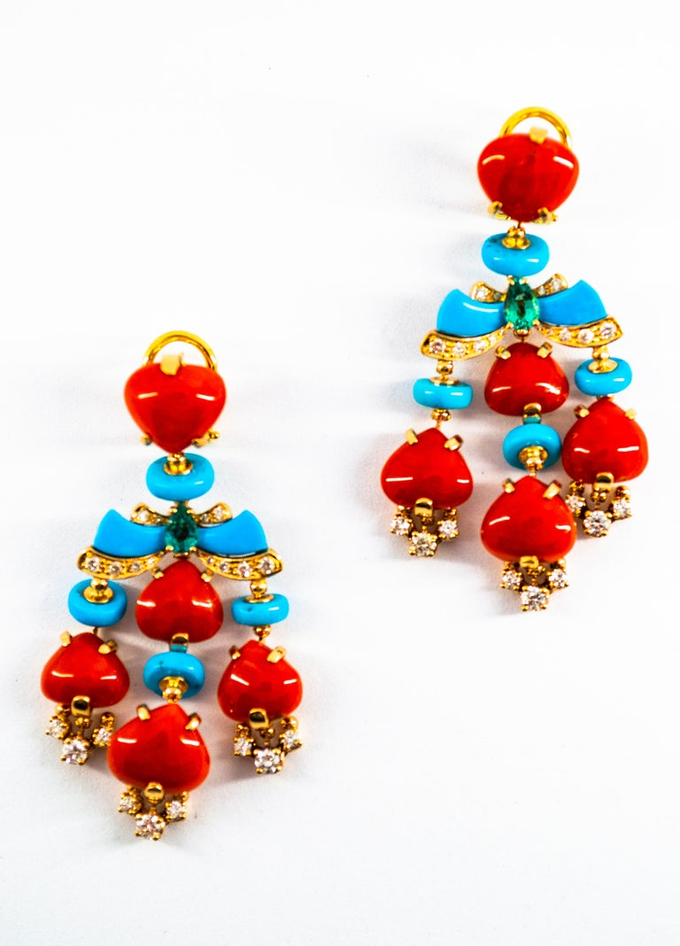 These Earrings are made of 14K Yellow Gold. These Earrings have 1.35 Carats of White Modern Round Cut Diamonds. These Earrings have 0.50 Carats of Emeralds. These Earrings have also Mediterranean (Sardinia, Italy) Red Coral and Turquoise. All our