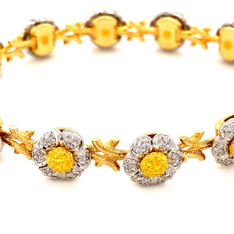 Art-Deco Style White Diamond, Yellow and White Gold Bracelet:  An Art-Deco Style inspired piece, it features 282 white round brilliant diamonds weighing a total of 2.11 carat. The bracelet has been crafted using the topmost craftsmanship possible,