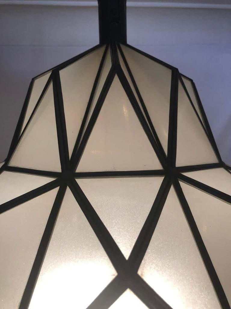 A stunning Art Deco style dome form milk glass white chandelier or lantern. Having individual panes, possessing an open door pane leading to a double recently wired setting housing one sixty watts bulbs. These fine custom lantern are sure to light