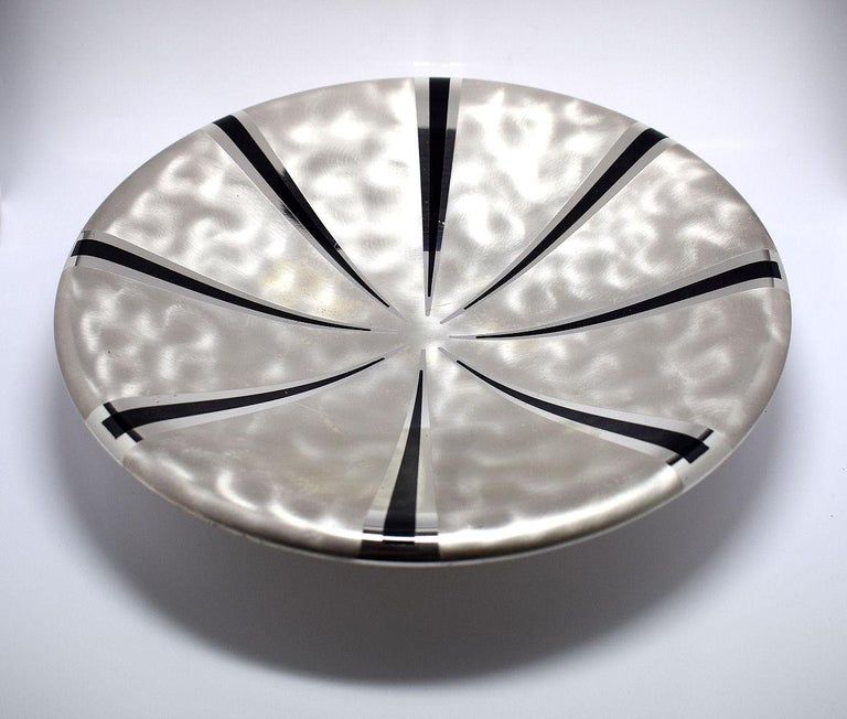 Wonderfully stylish Art Deco silver plated bowl by WMF Ikora. A shallow bowl decorated internally with black radial lines which splay outwards from the centre. Underneath are three circular ball shaped feet. Marked with impressed WMF and Ikora with