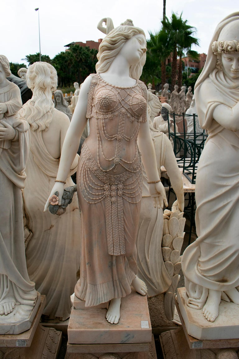 Art-deco woman sculpture hand carved in Portuguese Rosa and Carrara white marble.