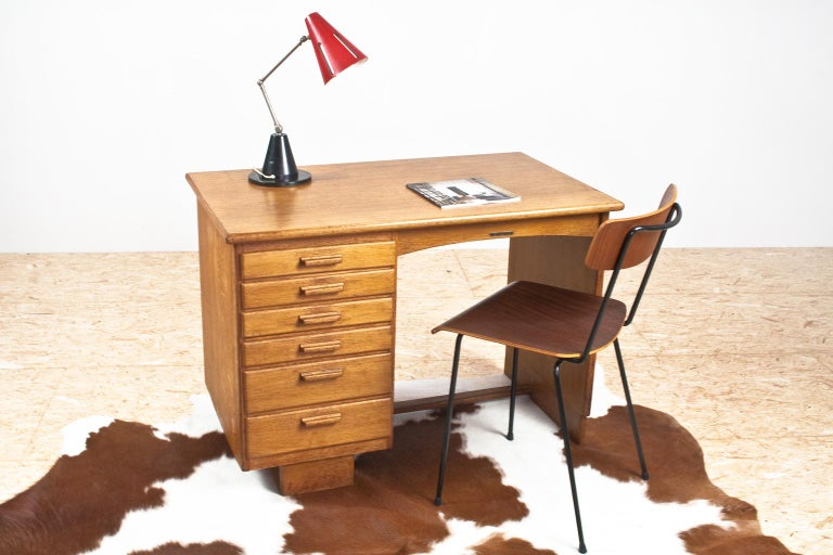 Elegant and petit Art Deco writing table and desk in solid oak with an extendable desk top (extra width of 28 cm, 11 inch) on the right of the secrétaire, 1930s, Netherlands. The item features a series of different size drawers. All in good vintage