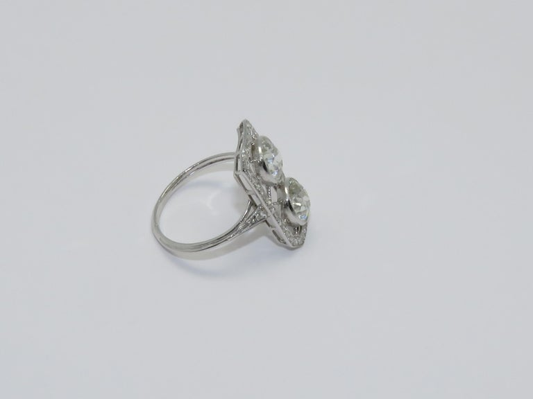 Art Deco bypass ring in Diamonds and Platinum. Diamond Old European Cut Diamond approximately: 2 x 1.40 Ct  Ring size: 56      7 1/4 US  Measurements: Length: 0.83 in ( 2.10 cm )     Width: 0.47 in ( 1.20 cm )     Height: 0.87 in ( 2.20 cm )