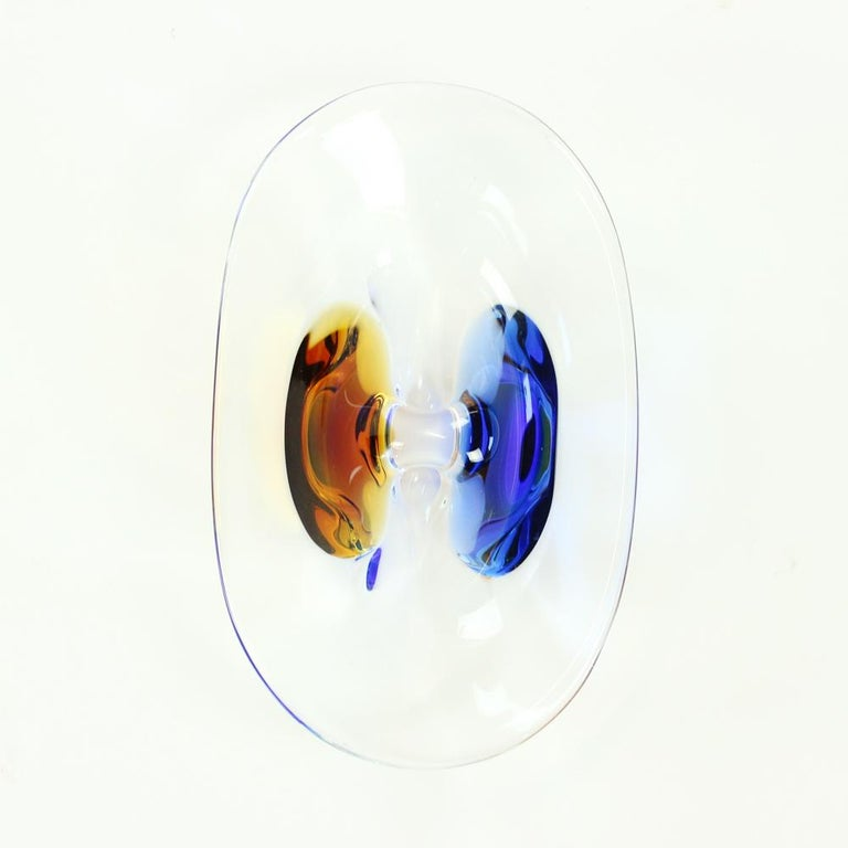 Beautiful metallurgical glass bowl from designer Frantisek Zemek. Excellent condition without any wear or signs of use. Made of clear metallurgical glass with amber and cobalt glass details. Strong and heavy bowl, suitable to any interior.