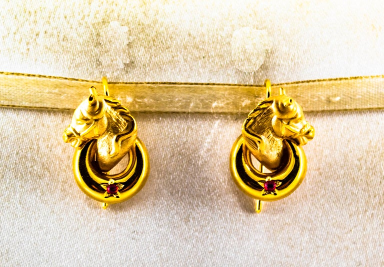 These Earrings are made of 14K Yellow Gold. These Earrings have 0.10 Carats of Rubies. All our Earrings have pins for pierced ears but we can change the closure and make any of our Earrings suitable even for non-pierced ears. We're a workshop so
