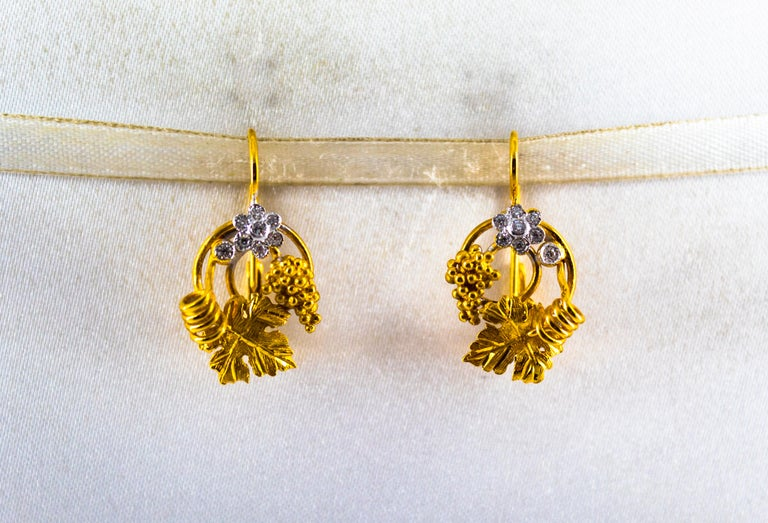 These Earrings are made of 14K Yellow Gold. These Earrings have 0.18 Carats of White Diamonds. These Earrings are inspired by Art Nouveau. All our Earrings have pins for pierced ears but we can change the closure and make any of our Earrings