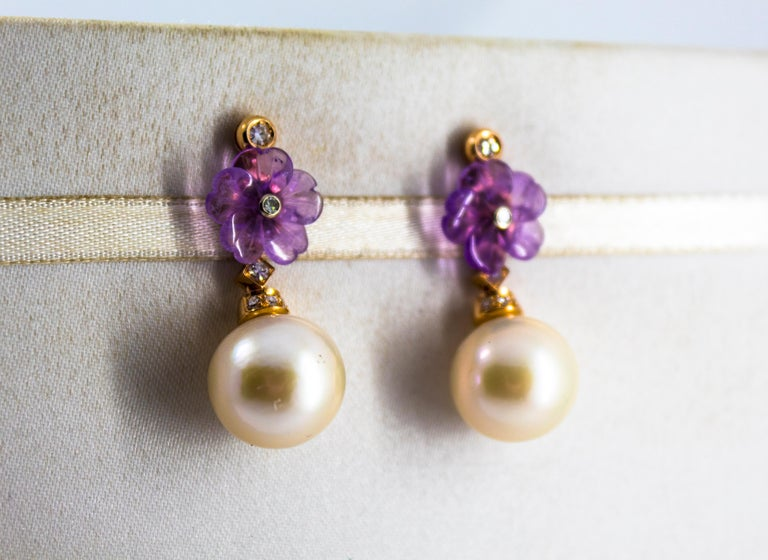 These Stud Earrings are made of 14K Yellow Gold. These Earrings have 0.20 Carats of White Diamonds. These Earrings have also 35.00 Carats of Pearls and Amethyst. These Earrings are available also with Green Flowers made of Agate or White Flowers