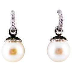 Art Nouveau 0.55 Carat White Diamond Emerald Pearl White Gold Dangle Earrings