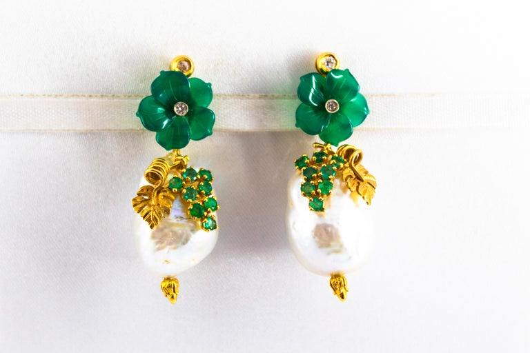 These Stud Earrings are made of 14K Yellow Gold. These Earrings have 0.12 Carats of White Diamonds. These Earrings have 0.90 Carats of Emeralds. These Earrings have also Freshwater Pearls and Agate. These Earrings are available also with Purple