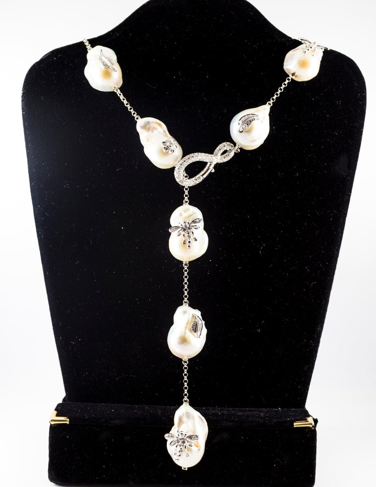 This Necklace is made of 18K White Gold. This Necklace has 1.75 Carats of White Diamonds. This Necklace has 342.00 Carats of Pearls. We're a workshop so every piece is handmade, customizable and resizable.