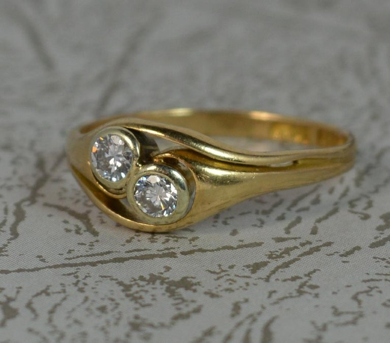A stunning Art Nouveau period ring. Solid 18 carat yellow gold piece with front platinum bezel. Set with two natural diamonds, bright and sparkly, 0.14ct each. 6.9mm wide band to the front. Circa 1910. SIZE ; M 1/2 UK, 6 1/2 US CONDITION ; Very good
