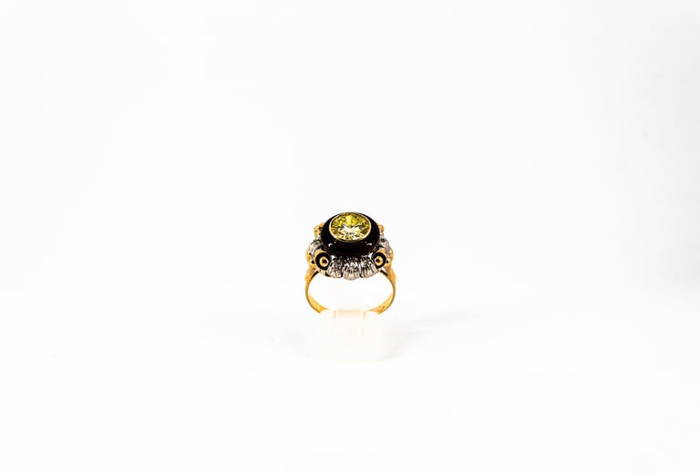 This Ring is made of 18K Yellow and White Gold. This Ring has a 1.80 Carats White Old European Cut Diamond. This Ring has 0.19 Carats of White Modern Round Cut Diamonds. This Ring has also Onyx. This Ring is inspired by Art Nouveau. Size ITA: 21