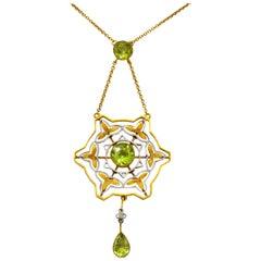 Art Nouveau 2.60 Carat Peridot Platinum 14 Karat Gold Drop Necklace