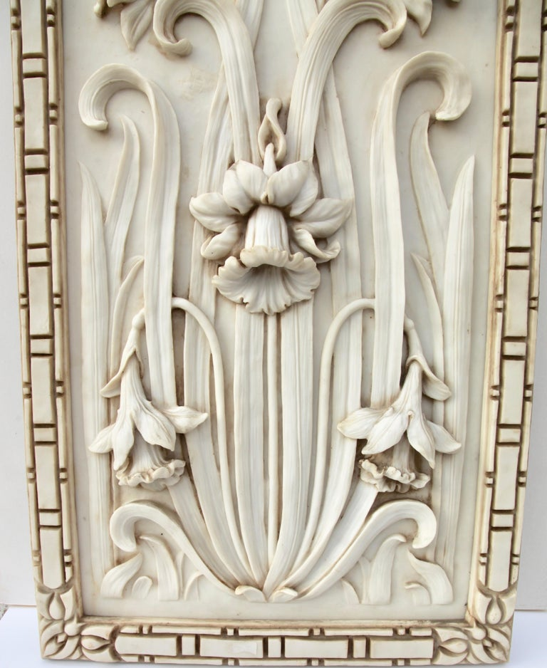 Large decorative alabaster panel with Art Nouveau design. Dramatic high-relief sculpture of daffodils (Jonquils) with leaves and flower heads in 3-D. Such items were typically used as decorative panels in the home. The alabaster has a light cream