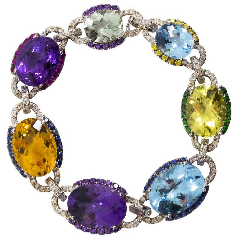 Art Nouveau 5.80 Carat White Diamond Ruby Sapphire Emerald White Gold Bracelet For Sale