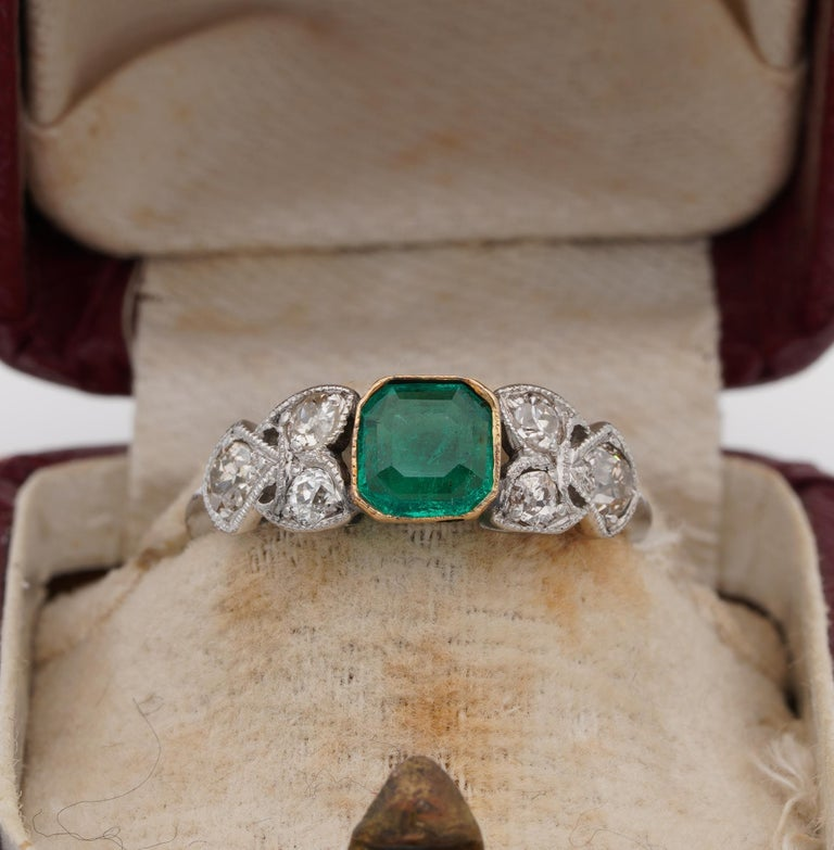 Art Nouveau Rarity  Of rare beauty, exquisitely designed during the Art Nouveau period this unique ring set with Colombian Emerald and old mine Diamond ring Hand crafted of solid Platinum except the Emerald setting which has been made of solid 18 KT