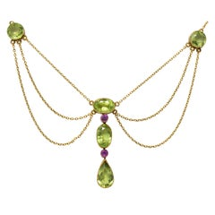 Art Nouveau 6.65 Carat Peridot Tourmaline 14 Karat Gold Swag Drop Necklace