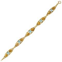 Art Nouveau 7.50 Carat Blue Zircon 14 Karat Gold Leaf Bracelet