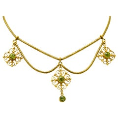 Art Nouveau 8.50 Carat Peridot 14 Karat Gold Swag Necklace