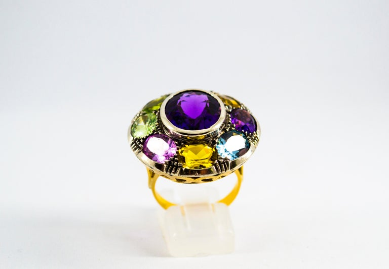 This Ring is made of 9K Yellow Gold and Sterling Silver. This Ring has Amethyst, Peridot, Citrine, Lemon Quartz, Blue Topaz. This Ring is inspired by Art Nouveau. Size ITA: 18 USA: 8 1/4 We're a workshop so every piece is handmade, customizable and