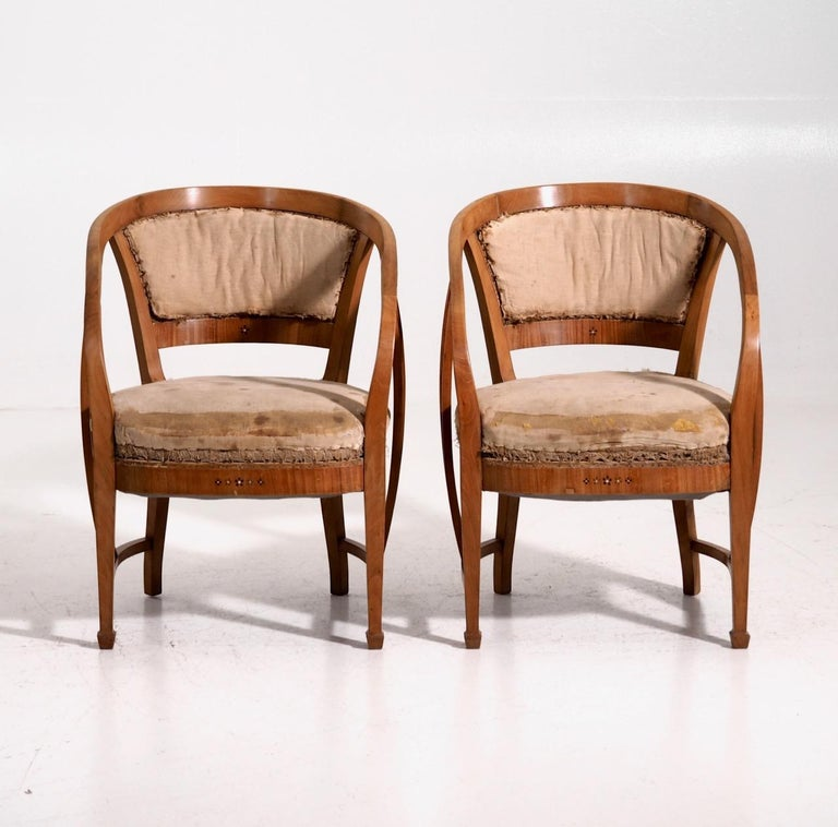 Pair of very rare Art Nouveau armchairs. Probably by one of the famous Austrian architects, made in cherrywood. Inlaid with mother of pearl and with various fruitwood, circa 1905.