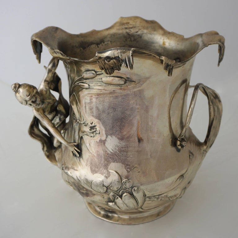 Art Nouveau WMF silver plated pewter champagne bucket with high relief decoration, Germany, circa 1906. In very good original condition, as shown in the pictures. Can also be used as a vase.  By 1900 WMF was the world's largest producer of