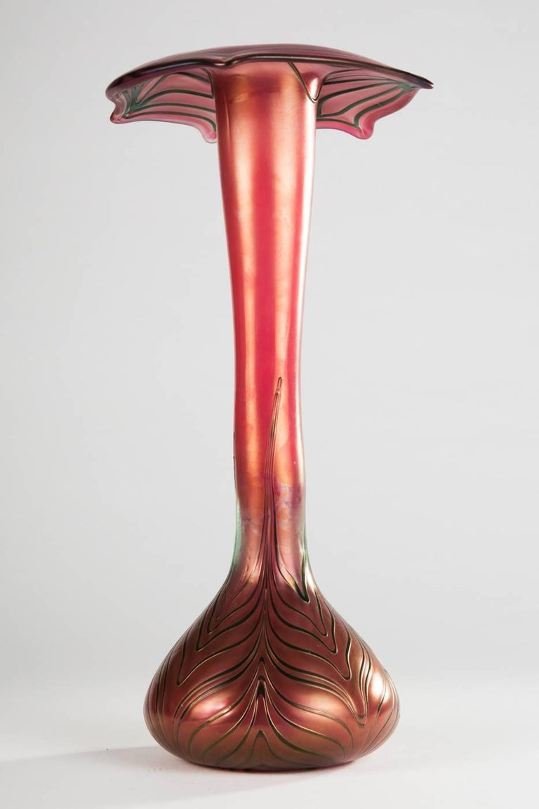 Bohemian glass vase, red tinted glass with spiral melting,  H. approx. 28 cm, minimally rubbed.