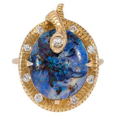 Art Nouveau Boulder Opal Ring with Textured Gold and Diamond Serpent Motif