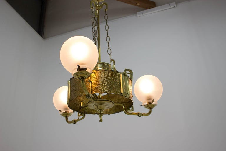 Formerly gas Art Nouveau brass chandelier from the beginning of 20th century, then remade for electricity, now new rewired, 3xE27, 3x60W, up to 250V. Completely restored.