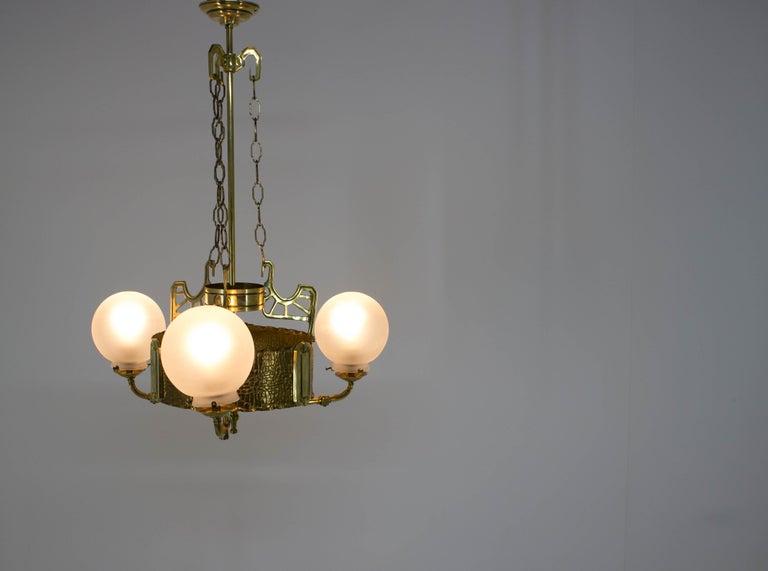 European Art Nouveau Brass Chandelier, 1910s For Sale