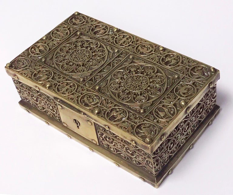 Brass Jewellery Box, Germany C.1920 probably Erhard & Söhne of Schwäbisch Gmünd. The box of rectangular shape, the brass body and cover oxidised inlay classic art nouveau arabesque decoration featuring panels with images of mythological creatures on